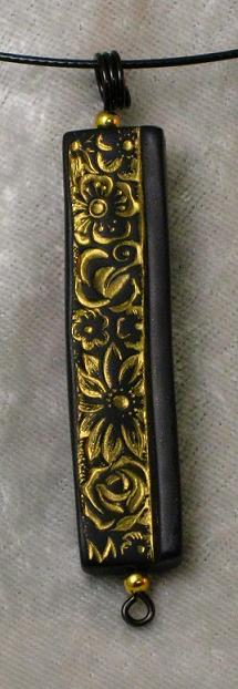 Gold Flowers on Black Pendant
