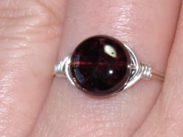 Beautiful sterling silver and Garnet wire wrapped ring