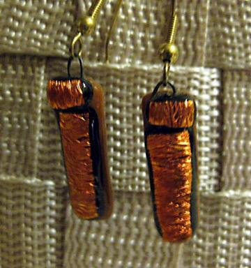 Earrings in burnt orange dichroic fused glass