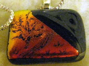 Red orange etched dichroic and black necklace