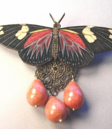 orange/black butterfly with coral drops