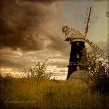Blowing away the black clouds - 8x8 fine art photography print Norfolk Broads windmill