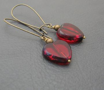 Ruby Heart earrings: deep red glass hearts with a stony edge, on long bronze-coloured ear-wires