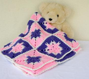 Hand crocheted little girl granny square afghan pink purple white special stitches cable stitch joining washable home decor nursery crib blanket throw warm winter pretty starburst