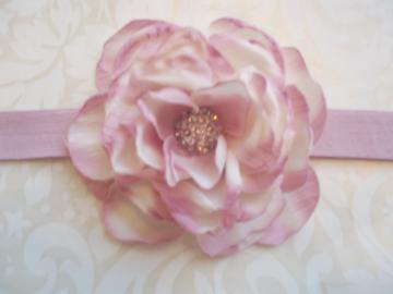 Misty Mauve Parisian Rose in shades of cream and mauve with a pink rhinestone dome center set on a mauve soft stretch headband
