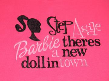 Step Aside Baribe theres a new doll in town  T-Shirt or Onesie