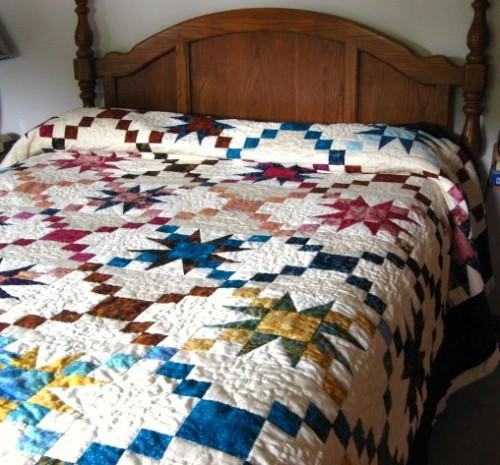 King size handmade quilt with matching shams in royal purple and gold