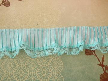 Pleaded in blue  satin and lace ruffled Trim