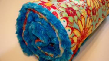 Turquoise Floral Minky in Yellow and Orange Backed with Turquoise Minky Swirl 30 x 36
