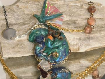 blue and green steampunk dragon pendant with decorative gold, gunnmetal, silver chain