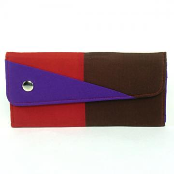 Clutch wallet with coin purse in color blocked red, brown, and purple.