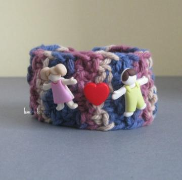 kids holding hands knitted bracelet