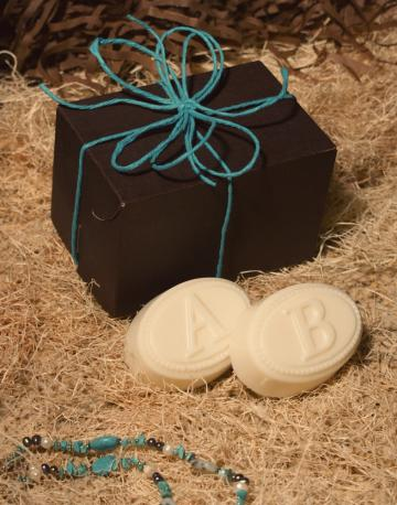 two bars of personalized monogrammed soap with the letter of your choice