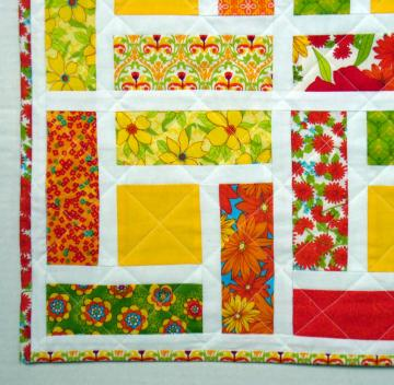 Patchwork table topper in bright colors
