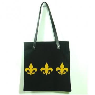 Black and Gold tote with faux leather handles and fleur de lis applique