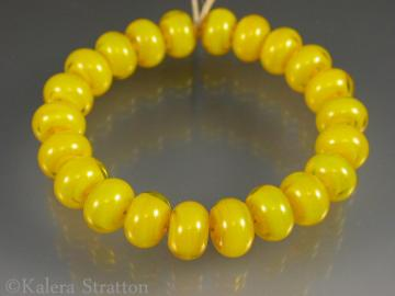 """Butterscotch"" Translucent yellow lampwork beads - set of 22 - Beadwife SRA"