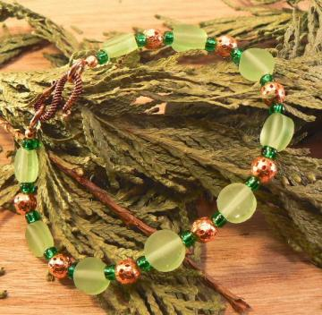 Green beads with copper and dark green glass bracelet 8 inches