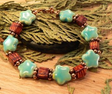 Yellow and green ceramic stars with wood cubes and copper bracelet
