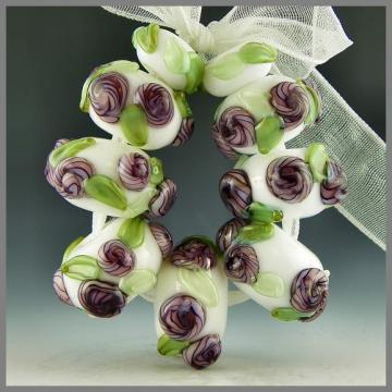 handmade lampwork beads set of 9 raised purple flowers green leaves on white - Frills