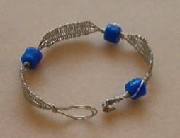 Wire weave bracelet with blue African trade beads