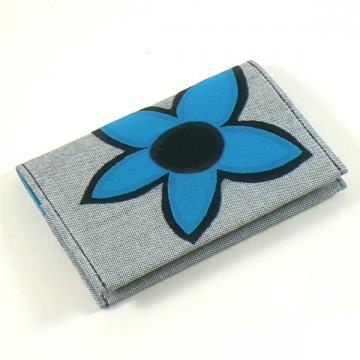 Mini wallet in grey with electric blue floral applique.