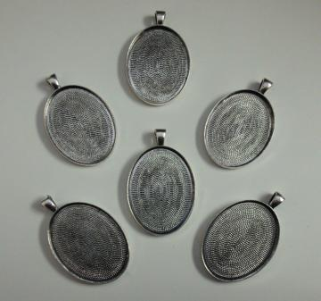 6 antique silver tone pendants with 40x30 glue in settings