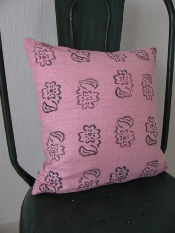 Pink linen cushion with black flowers