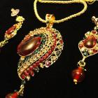 VINTAGE 80s Demi Parure gold tone Large tear Shape Ruby Lucite cabochon in a Rhinestone Pendant with earring