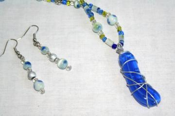 set blue glass wire wrapped pendant and earrings