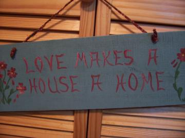 LOVE MAKES A HOUSE A HOME Sign