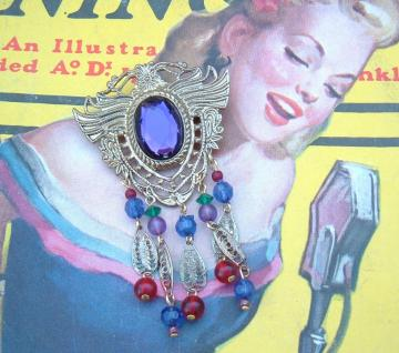 Retro Plastic and metal dangler brooch