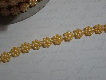 1yd - Mini Lt. Orange Daisy Pearl Trim