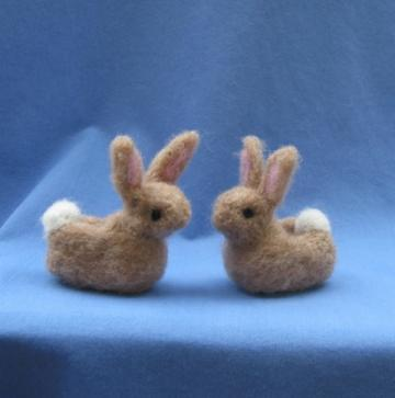 Bunny Slippers, 2.5 inches long. Needle felted wool figures, light brown with pink inside the ears and inner soles.