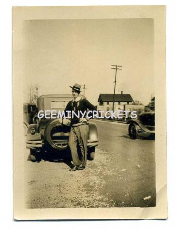 MAN LEANING ON OLD VEHICLE SNAPSHOT
