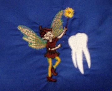 Embroidered boy tooth fairy pillow on blue flannel