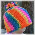 Bright Rainbow Crocheted Toddler Hat with Flower Top