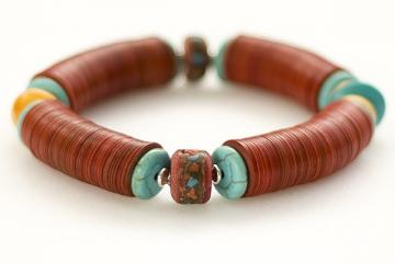Bracelet of red vinyl, turquoise, Baltic amber, features Tibetan mala beads