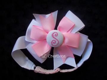 Adjustable ribbon headband with removable embroide