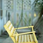 A Yellow Swing Graces a Lovely Porch Fine Art Photo