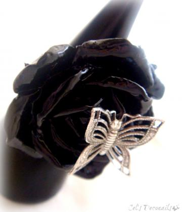 Silver butterfly on a black rose Gothic ring