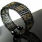 Black wire knit bangle with black and bronze cubes
