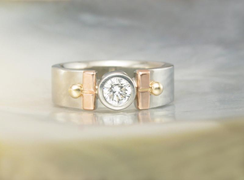 Unique Artisan Engagement Ring With Bezel Set Diamond